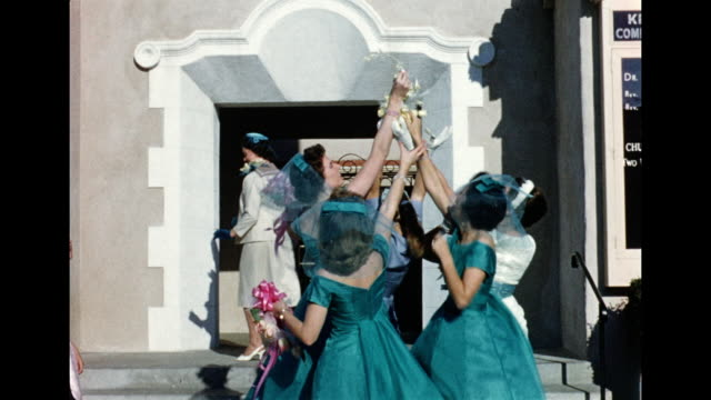 vídeos de stock, filmes e b-roll de 1962 wedding - bouquet and garter toss - bridesmaid