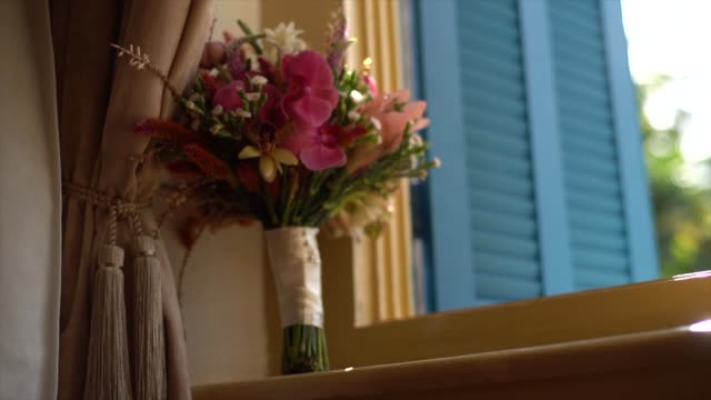 wedding bouquet close to window - bouquet stock videos & royalty-free footage
