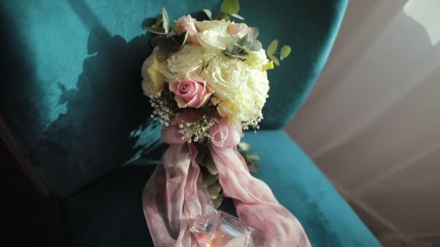 wedding bouquet flower arrangement on sofa chair - flower arrangement stock videos & royalty-free footage