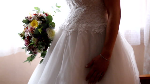 wedding bouquet in hands of the bride - dress stock videos & royalty-free footage