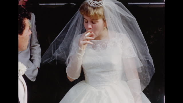 1962 wedding - bride smoking a cigarette - sigaretta video stock e b–roll