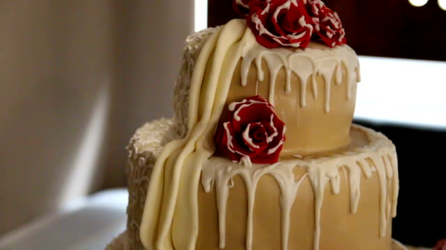 wedding cake decorated with red flowers - sweet food stock videos and b-roll footage