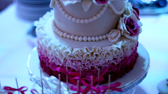Wedding cake decorated with violet flowers