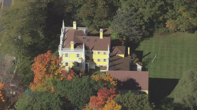 Aerial Wedding Cake House Among Trees In Fall Colors Kennebunk Maine