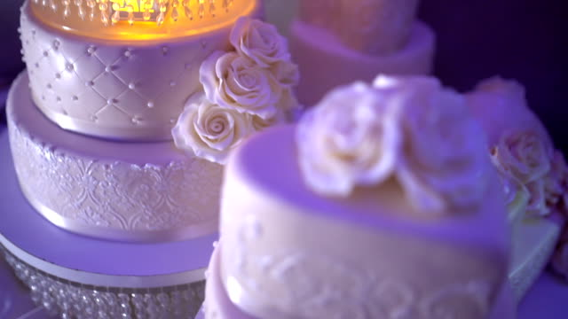 wedding cake - stock video - decorating stock videos & royalty-free footage