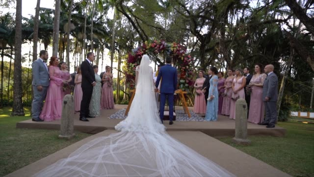 wedding ceremony at farm with groom, bride, family and guests in the altar - christianity stock videos & royalty-free footage