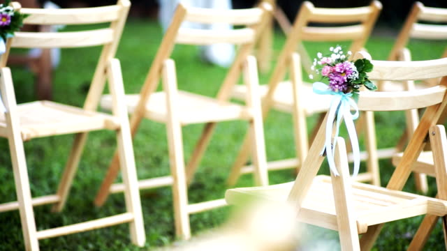 Wedding chairs decorated with flowers.