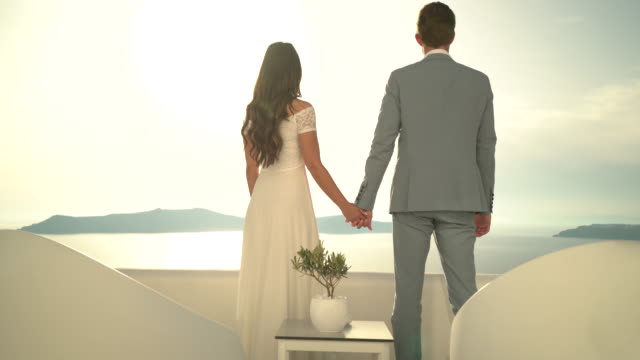 wedding couple on luxury terrace at sunset