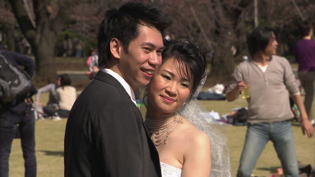 CU Wedding couple posing in park, Tokyo, Japan