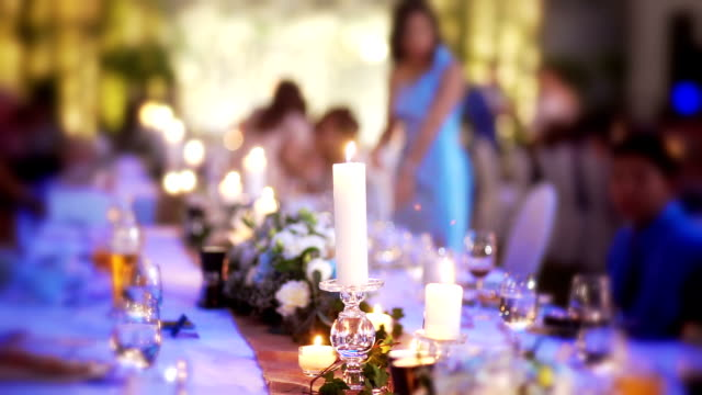 wedding decoration with bouquet of flowers and candles on the table for guests. - guest stock videos & royalty-free footage