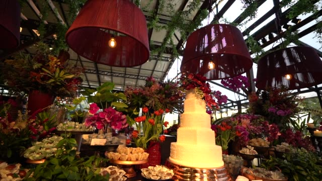 wedding dessert table with flowers - arranging stock videos & royalty-free footage