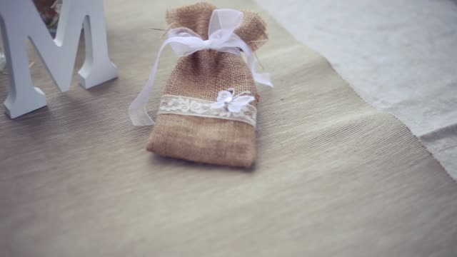 Wedding details with fabric bag and wooden letter