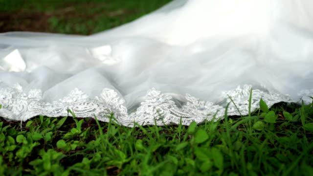 wedding dress on green grass