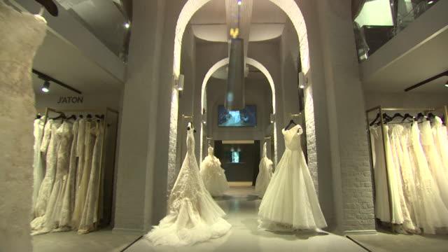 wedding dresses on display at wedding gallery - luxury stock videos & royalty-free footage