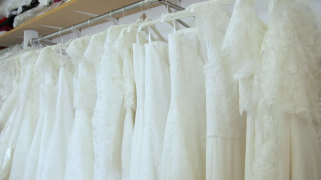 cu tu wedding dresses with lace on hangars / united kingdom - wedding dress stock videos and b-roll footage