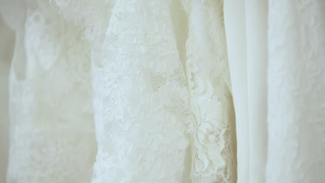 ECU TU Wedding dresses with lace on hangars / United Kingdom