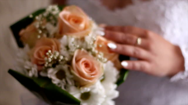 Wedding flowers in bride's hands