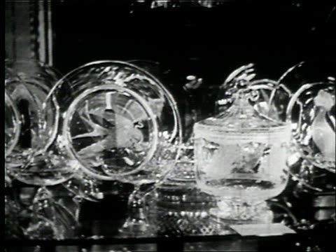 wedding gifts for prince philip and princess elizabeth are received by the couple, including crystal pieces, china, picnic camper, swiss watch,... - anno 1947 video stock e b–roll