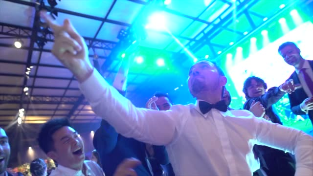 wedding guests dancing during party - arms raised stock videos & royalty-free footage