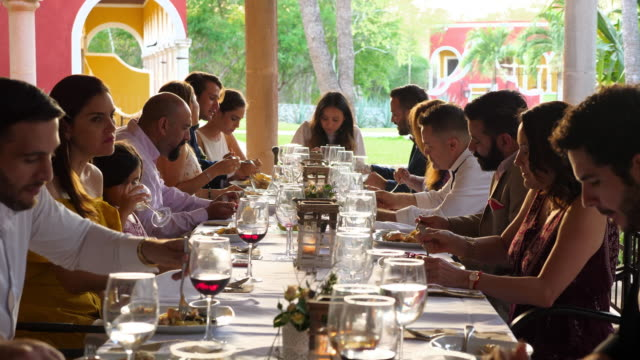 ms wedding guests seated at table for dinner during outdoor wedding reception - guest stock videos & royalty-free footage