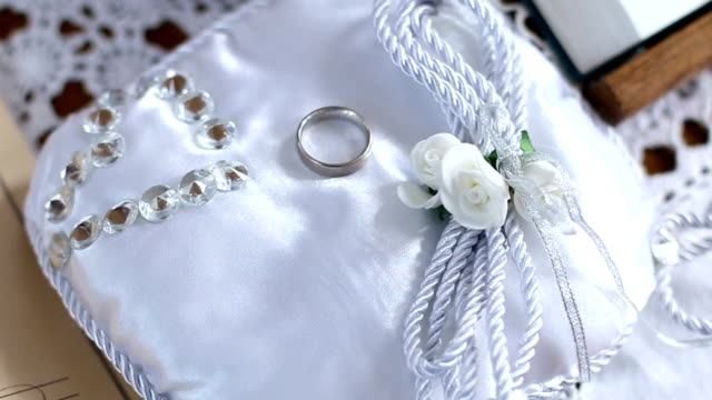 wedding ring on the lace pillow - lace textile stock videos & royalty-free footage