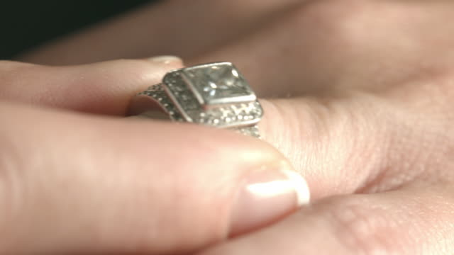 ecu wedding ring slipped onto finger of woman  - ehering stock-videos und b-roll-filmmaterial