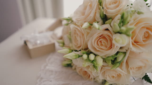 wedding rings and flowers close-up with shallow depth of field. flower arrangement in elegant wedding decoration. - flower arrangement stock videos & royalty-free footage