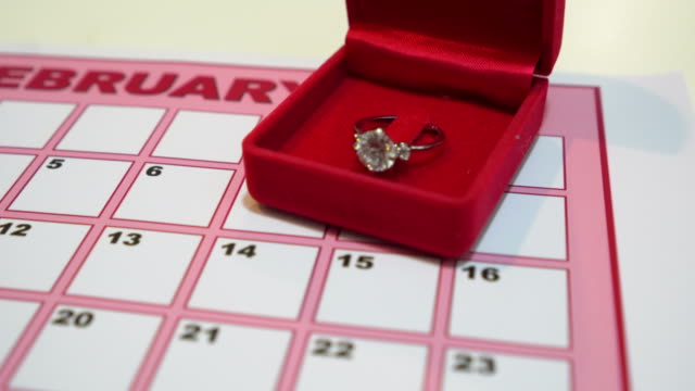 wedding rings for valentines day on calendar - jewelry box stock videos and b-roll footage