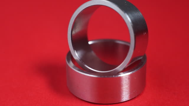 wedding rings on red background. 360 degree turn - for sale stock videos & royalty-free footage