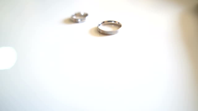 wedding rings on the white background - wedding ring stock videos & royalty-free footage