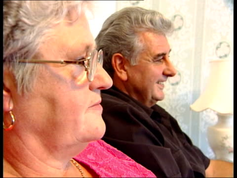 wedding saved by mobile phone; itn wales: int side cms john davies & barbara davies sitting watching video of their son's wedding television showing... - television show stock videos & royalty-free footage