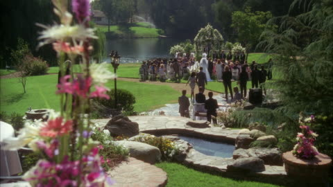 ms pan zi wedding taking place near pond in garden of large estate - 1990 stock videos & royalty-free footage