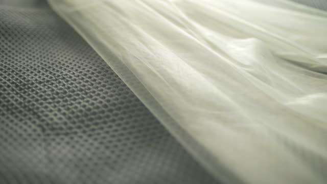 Wedding veil on bed