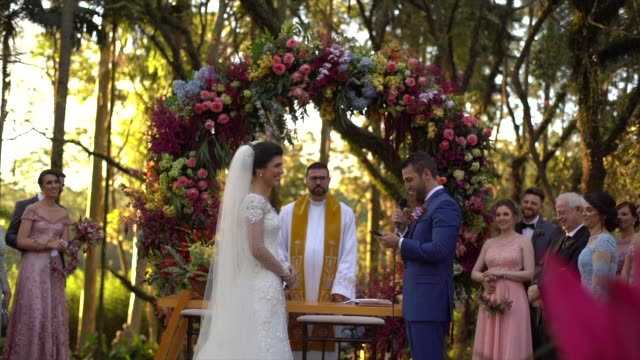 wedding vows during outdoor wedding ceremony - christianity stock videos & royalty-free footage
