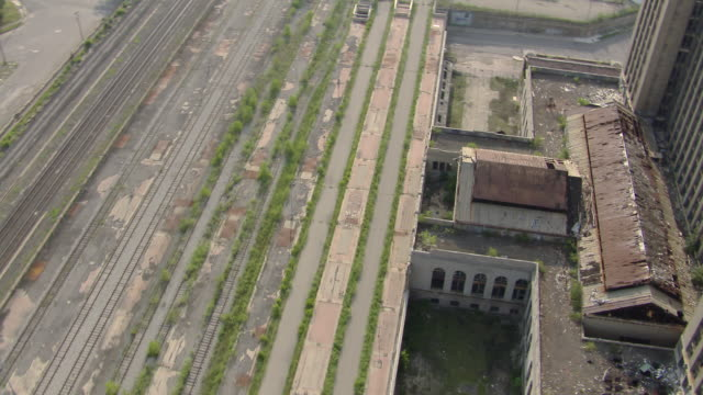 Weeds grow on the train tracks of the deserted Michigan Central Station, Detroit's main train station until the late 1980's