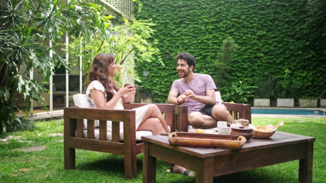 weekend breakfast and conversation outdoors in backyard - lifestyles stock videos & royalty-free footage