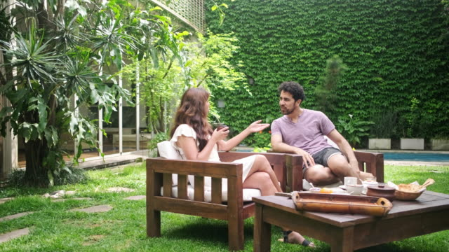 weekend breakfast and conversation outdoors in backyard - furniture stock videos & royalty-free footage