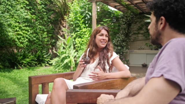 weekend breakfast and conversation outdoors in backyard - close to stock videos & royalty-free footage