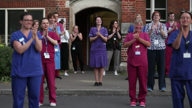 weekly clap for carers outside the royal hampshire county hospital in winchester - hampshire england stock videos & royalty-free footage