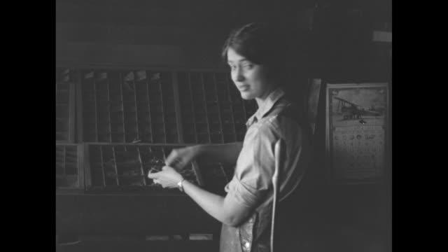 weekly courier owner/publisher mary edith blythe sitting at desk writing / blythe sitting at desk operating linotype machine / blythe setting up type... - 1928 stock videos & royalty-free footage
