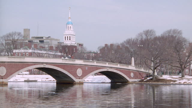weeks memorial bridge spans the charles river to the harvard university campus. - ivy league university stock videos & royalty-free footage