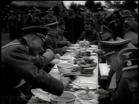 vidéos et rushes de wehrmacht officers eating dinner at an outdoor picnic table / sudetenland czechoslovakia - wehrmacht