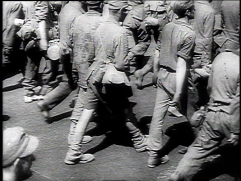 wehrmacht prisoners of war marching through the streets of moscow / women watching them pass with satisfied expressions - 1944 stock videos and b-roll footage