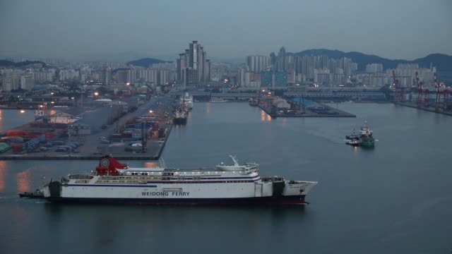stockvideo's en b-roll-footage met a weidong ferry sails past the port of incheon at dusk in incheon south korea on monday sept 4 2017 - incheon
