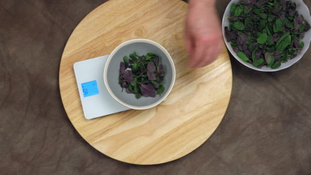 weighing basil leaves. - measuring stock videos & royalty-free footage