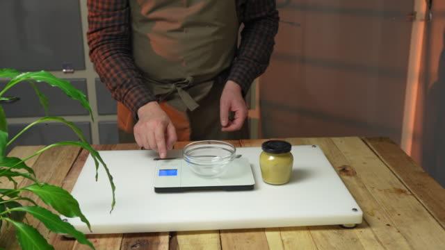 weighing mustard - savoury sauce stock videos & royalty-free footage