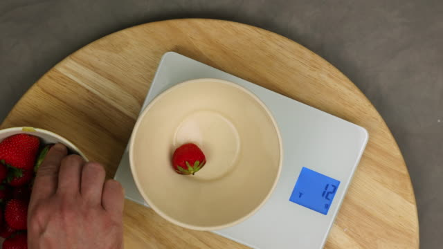 weighing strawberries - weight scale stock videos & royalty-free footage