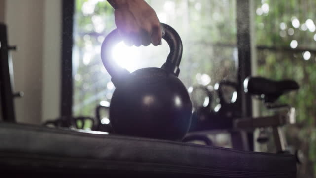 weight training is a habit worth picking up - kettlebell stock videos & royalty-free footage