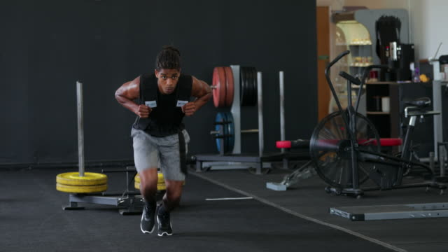 weighted sled exercise in the gym - endurance stock videos & royalty-free footage