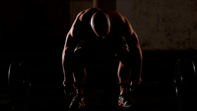重量挙げ - ウェイトトレーニング用器具点の映像素材/bロール